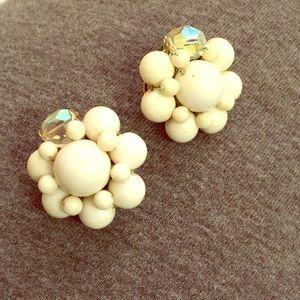 White and aurora borealis glass bead clip earrings